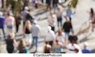 Defocused crowd of people, road intersection crosswalk on The Strip of Las Vegas, USA. Anonymous blurred pedestrians on walkway in crowded urban downtown. Unrecognizable american citizens in sin city