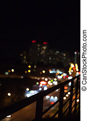 Defocused different color night lights of the city