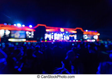 Defocused entertainment concert lighting on stage, blurred disco party, blurry background