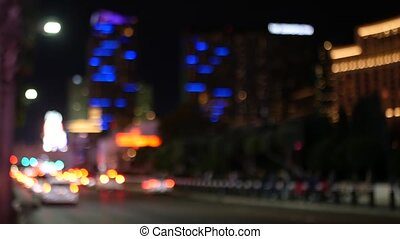 Defocused fabulous Las Vegas Strip boulevard, luxury casino and hotel, gambling area in Nevada, USA. Nightlife and traffic near Fremont street in tourist money playing resort. Neon lights of sin city.