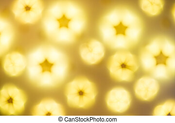 Defocused golden abstract Christmas Glitter Lights stars Background