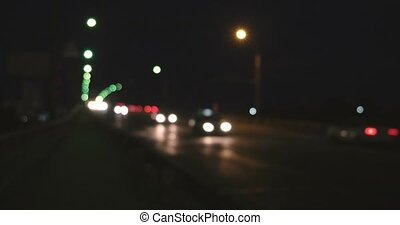 Defocused headlights and tail lights of approaching highway...