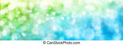 Defocused highlights in green and blue, panorama format -...