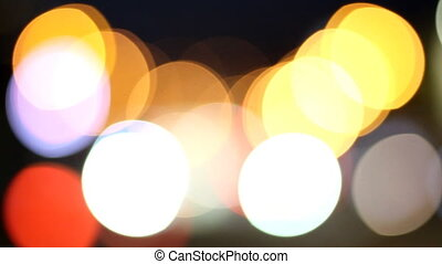 Defocused highway traffic during evening rush hour. The big defocused lights turn small