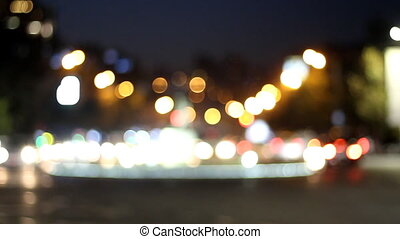 Defocused highway traffic during evening rush hour. The small defocused lights turn big