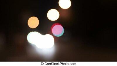 Defocused lights in night time. Nightlife of the city.