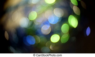Defocused lights of Christmas holiday decorations. Art bokeh of blue and green color