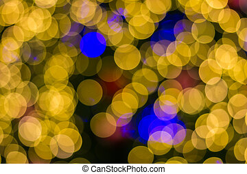 Defocused ligths of golden Christmas tree