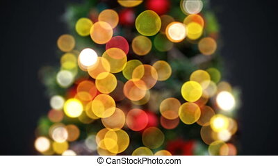 Defocused New Year Tree Lights Blinking Seamless on Black Background. Looped 3d Animation. Merry Christmas and Happy New Year Concept. 4k Ultra HD 3840x2160