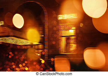 Defocused night city scene with Hotel sign