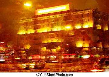 Defocused night city scene with orange illumination