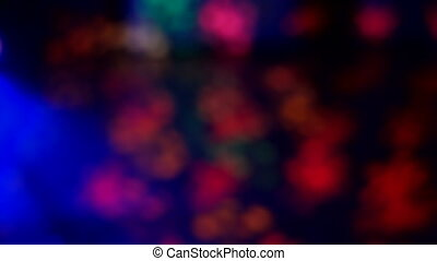 Defocused night club lights, blurred colorful bokeh background.