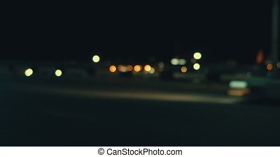 Defocused night traffic lights in hyperlapse style side look at freeway
