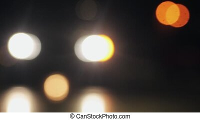 Defocused night traffic lights. Night city