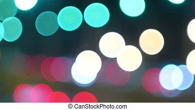 Defocused night traffic lights of cars head- and backlights....