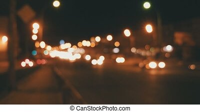 Defocused night traffic on overpass gimbal shot warm color