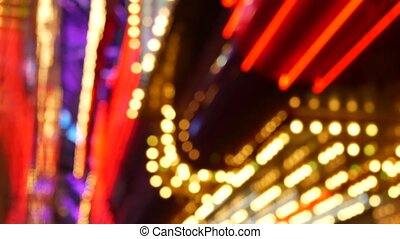 Defocused old fasioned electric lamps glowing at night. ...