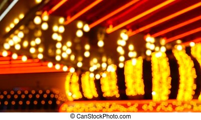 Defocused old fasioned electric lamps glowing at night. Abstract close up of blurred retro casino decoration shimmering, Las Vegas USA. Illuminated vintage style bulbs glittering on Freemont street.