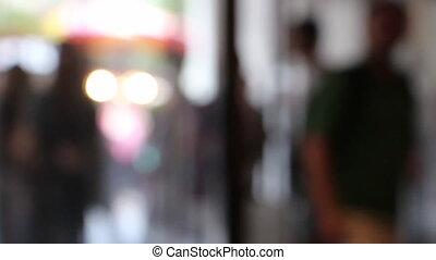 defocused people enter shop - Shot of defocused people enter...