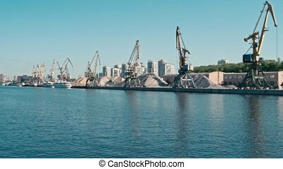 Defocused port Cranes Of Old Northern River Port On...