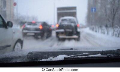 Defocused scene with cars in snow