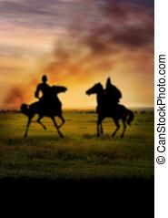 Defocused silhouette of two horseman acient warriors