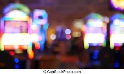 Defocused slot machines glow in casino on fabulous Las Vegas...