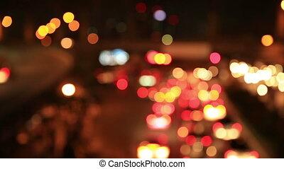 defocused traffic car light at night