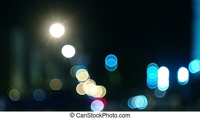 Defocused traffic in a city at night time