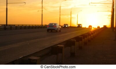 Defocused traffic in slow motion in sunset time