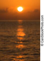 Defocused tropical ocean sunset background