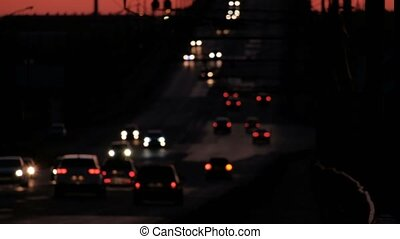 Defocused twilight traffic. Blurred Cars Moving In The...