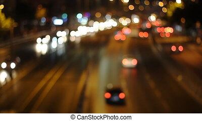 Defocused urban abstract texture ,blurred background with bokeh of city lights from car on street at night, vintage or retro color tone