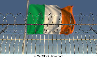 Defocused waving flag of Ireland behind barbed wire fence. 3D rendering