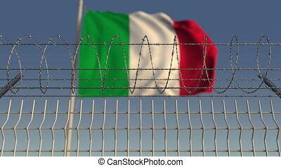 Defocused waving flag of Italy behind barbed wire fence. Loopable 3D animation