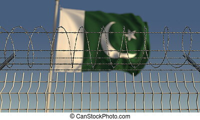 Defocused waving flag of Pakistan behind barbed wire fence. 3D rendering