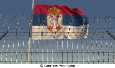 Defocused waving flag of Serbia behind barbed wire fence. Loopable 3D animation