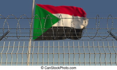 Defocused waving flag of Sudan behind barbed wire fence. 3D rendering
