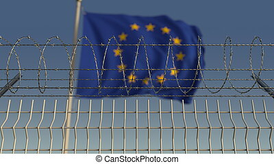 Defocused waving flag of the European Union EU behind barbed wire fence. 3D rendering