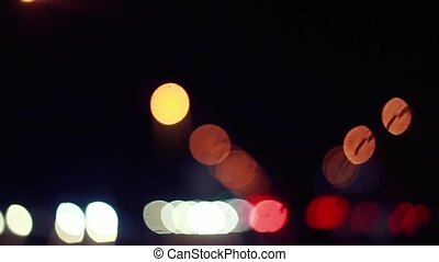 Defocusing background on night road with bokeh. 1920x1080. hd
