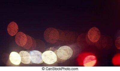 Defocusing background on night road with bokeh.