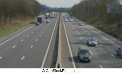 Defocussed blurry motion on UK Motorway sunny evening.