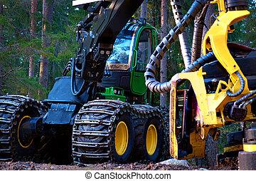 Deforestation - Heavy machine used for deforestation in...