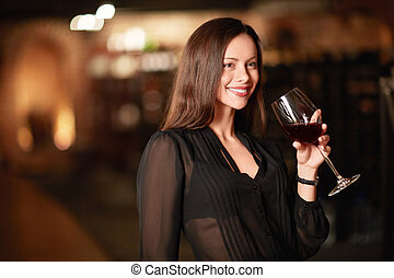 Degustation - Attractive woman in the wine cellar