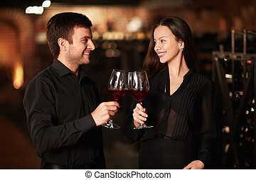 Degustation - Young couple in wine cellar