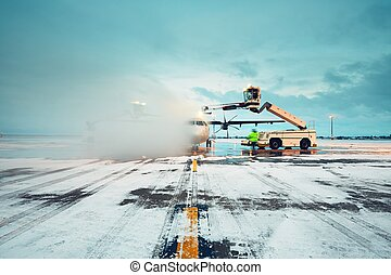 Deicing of the airplane - Airport in winter. Deicing of the...