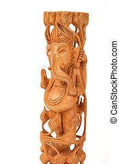Deity god of wisdom and prosperity Ganesha from India on a white background, wood