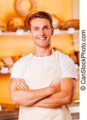delantal de la tienda, mantener, baker., joven, brazos, ...