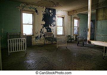 Delapidated Hospital Building With Empty Rusted Beds -...