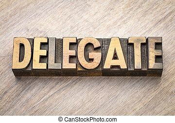 delegate word abstract in wood type